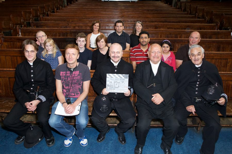 Red Rock Entertainment Investors and crew on set with Steven Berkoff.